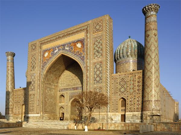 Sunrise above minarets of Registan complex, Samarkand, Uzbekistan.