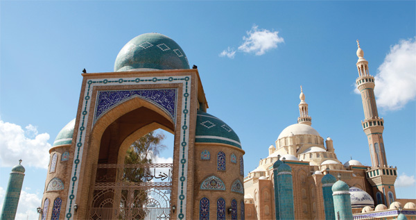 Jalil Khayat Mosque, Erbil, Iraq. The enormous mosque is a hidden gem in the pantheon of beautiful modern Islamic architecture, with colored tiled minarets and domes and the intangible vibrancy that must be experienced to be believed.