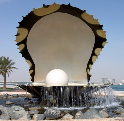 Monuments at the seven-mile Corniche, where visitors are greeted with grassy knolls and spacious views of the turquoise Arabian Gulf.