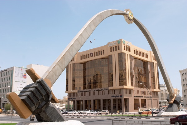 Each new building and sculpture carries its own unique style. Pictured: The Arch of Swords on Grand Hamad Avenue in Doha