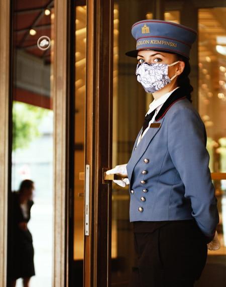 Kempinski Hotels Entrance Door Lady Mask and gloves - ALO Magazine